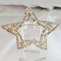This #vintage large rhinestone star brooch is just gorgeous!  It features a large pale gold tone abstract open double star filled with prong set clear rhinestones.  Rolling ... #ecochic #etsy #jewelry #jewellery #holiday2014etfs