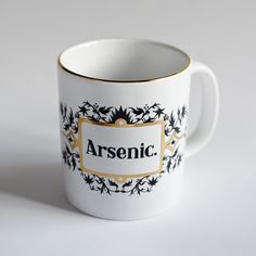 Limited edition art mug.Name your poison with this arsenic mug inspired by antique apothecary jars.Start your collection here as more poisons will be released each year.Due to the 22k gold detailing hand washing is recommended (not for use in microwaves)