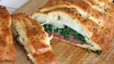 Corned beef, potatoes, spinach and melty white cheddar cheese all wrapped up in a crescent braid. Kiss me, I'm delicious.