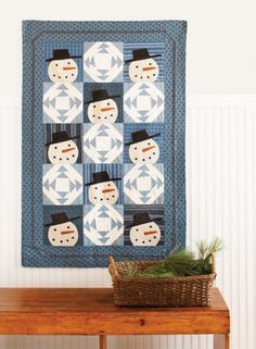 The weather outside may be frightful, but these quilts are oh-so delightful!  Winter motifs, cozy fabric, and frosty colors pair up for quilts you can  snuggle under all winter long.