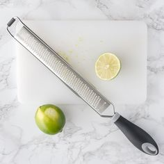 A necessary tool for any bar or kitchen, this zester and food grater makes citrus zesting, cheese grating, and adding flavor to any cocktail or meal a cinch. Cheese Grater, Butter Spread, Butter Knife, Bar Tools, Ginger Snaps, Knife Making, Bartender, Make It Simple, Spices
