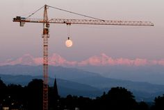 Most Perfectly Timed Photos Ever: moon crane perfect timing
