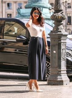 Never Underestimate Your White Tee: Priyanka stepped out in Paris in a pleated Dion Lee midi skirt, letting it take center stage by finishing her look with neutrals.