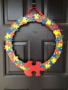 April is Autism Awareness Month..this is my take on the Autism awareness wreath..I used a flat wreath purchases at the craft store, both up cycled and new puzzle pieces(dollar tree), spray paint in primary colors, hot glue and ribbon(should be thicker)..Super cute..Super cheap and Super easy!!..