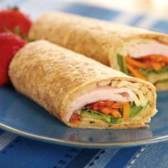 """1/4c shredded Monterey Jack cheese  1 multi-grain torilla 1oz thin sliced turkey breast/ 2T Squeeze Straw- berry Spread  2T julienne-cut carrots/ 2T shredded lettuce SPRINKLE cheese in middle of tortilla in a 4"""" circle. Microwave 15 sec. to melting cheese. PLACE turkey in a strip in  tortilla. Spread fruit on top of turkey. Sprinkle carrots & lettuce on top of turkey. Roll burrito style. Serve  immediately. If desired, Spread 1T Creamy Peanut Butter before the cheese."""