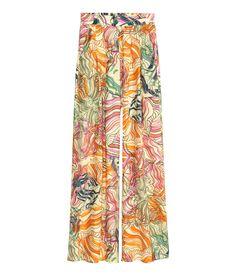 349 kr Lys beige/Mønstret. Vide bukser i vævet viskose. De har høj talje og elastik bagpå. Læg foroven og sidelommer.