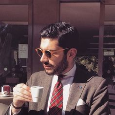 andy_fdr drinking an italian espresso and wearing Cran honey acetate frame with bottle green lenses from THE BESPOKE DUDES EYEWEAR.