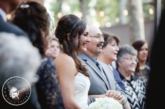 Jessica making her way down the aisle.  So happy!  Photo by Sposto Photography.