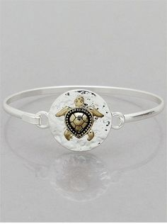 """Burnished silver tone link style turtle bracelet with magnetic closure. 1"""" H, 7 1/2"""" L"""