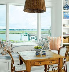 Simple breakfast table with a built-in bench and windows looking out over the bay