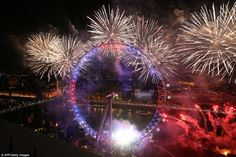 What a sight: Fireworks explode around the London Eye during the New Year celebrations in ...