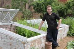 Gorgeous photo tour of kitchen garden at Deans Court in Dorset, UK. Use a foe rock wall to cut costs.