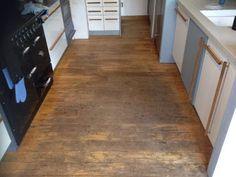 Worn floorboards in the kitchen