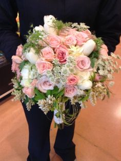 Pink spray roses with pink tulips, Queen Annes Lace and peirus and white hydrangea