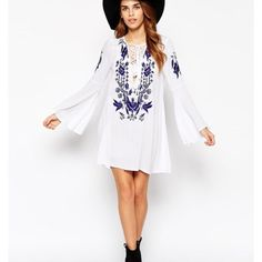 White Bell Sleeved Lace Up Dress Worn once. Tiny drain near bottom front. Runs small and fits more like a tunic Dresses