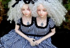 OK...I haven't seen conjoined twin dolls before...and yes, I want them.