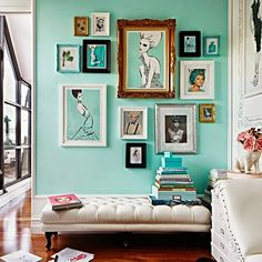 This gallery wall screams fun with the bold wall color, the subject matter & the varying frames!