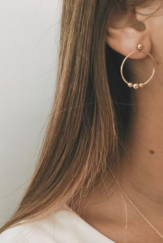 A personal favorite from my Etsy shop https://www.etsy.com/listing/618785033/porto-hoops-studs-delicate-ring-minimal