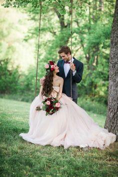Boho bride and groom on a swing for their portrait session! Love this wedding photography! Dark Red Boho Wedding www.elegantwedding.ca