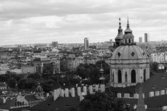 My work, the view from Prague castle . Prague is a great city and a must to visit if you are into travel photography. I like to process my photos in black and white,,