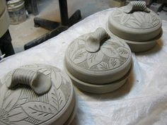 covered pottery butter/cheese dishes ready to fire...meesh's pottery. I need to try 2 coils spiraled around each other as a handle.