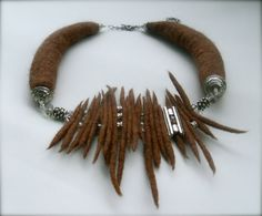 Necklace is made from merino wool, swarovski beads, copper silvered wire and Antique Silver Metal details.  Wool color is saddle brown  Necklace is 43 cm