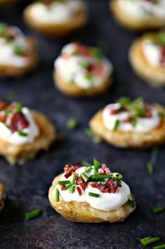 This recipe for Mini Potato Skins with Sour Cream, Bacon, and Chives is simple and delicious. These little bites are perfect for entertaining, especially during game season. Potato Appetizers, Easy Appetizer Recipes, Yummy Appetizers, Heavy Appetizers, Weeknight Recipes, Party Recipes, Mini Potatoes, Healthy Superbowl Snacks, Bite Size Food