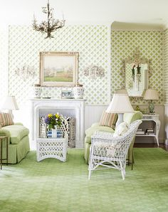 A green sitting room with white latticework wall covering in the Napa Valley home of Alexis Swanson Traina.