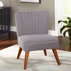 The Isabella Channel-back chair by Simple Living has a unique channell back creating an interesting appeal and providing a comfortable stylish seating option. In a beautiful grey fabric that is versatile and sure to enhance any decor.