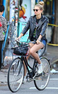 leather jacket, band tee, shorts, bun