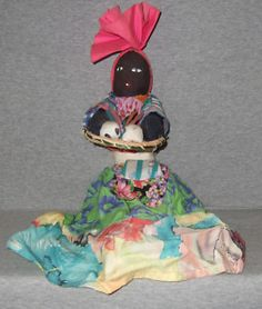 Caribbean cloth doll. Woman with basket.
