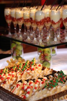 Strawberry shortcake parfait, Apples in cylinders to raise mirrored tile for display and a cookie basket.  Yum