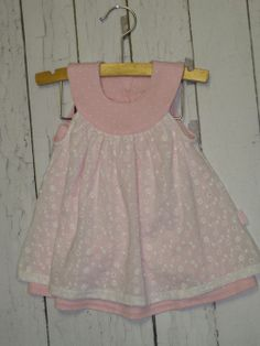 Le Top Pink and white eyelet infant 2 piece outfit.  Comes with ruffled diaper cover.  So sweet for a newborn or baby shower gift!!