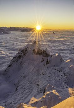 Over the Clouds Sunset on the mountain Säntis 2502m, Switzerland