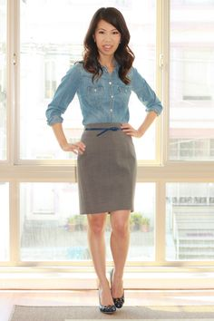 Denim with a tan skirt and navy blue belt