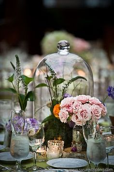 Table setting with roses, wilflowers and big bell jar/cloche