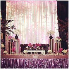 purple & white stage decor (Hello Kismet)