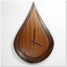 Teardrop clock - sSapele with walnut surround by David Barclay