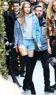 Gigi Hadid looking so chic in over-the-knee boots and a denim jacket