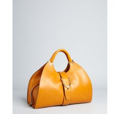 I've been wanting a mustard yellow bag for awhile now. This is awesome.  *love this bag*