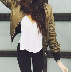 So hot and simple these fall outfit ideas that anyone can wear teen girls or women. The ultimate fall fashion guide for high school or college. A comfy look with a green bomber jacket, jeans and t shirt