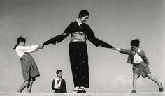 Photograph of a family, taken in the sand dune of Tottori. Shoji Ueda