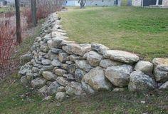 Glacial limestone boulder retaining wall