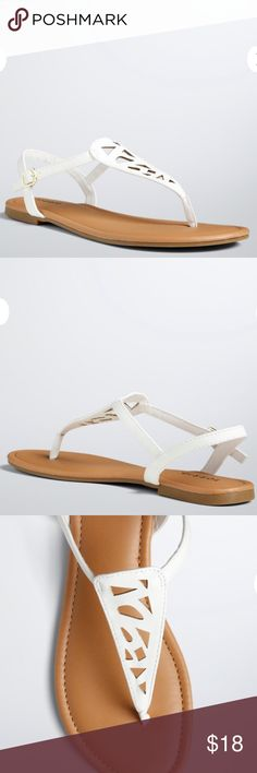 Torrid White Faux Leather Cutout T-Strap Sandals Up for grabs is this pair of wide width sandals from Torrid. They are a size 11.5W with flat soles. These sandals are thong style with behind the ankle straps. They are white with a faux leather panel that has cutouts and lays over the foot. These sandals have faux leather straps and a buckle closure. They are new with the original tag. *These sandals sold in the store without a box, so no box is included.* torrid Shoes Sandals