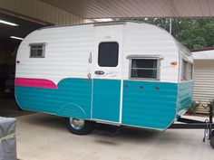 Finished my 1963 Garway. The teal part of the trailer is a vinyl wrap. Good thing about that is that if you want to change the color, all you have to do is peel it off and go with another color. Price is cheaper than paint. Vintage Rv, Vintage Caravans, Vintage Travel Trailers, Vintage Campers, Retro Campers, Airstream, Classic Campers, Classic Trailers, Camper Caravan