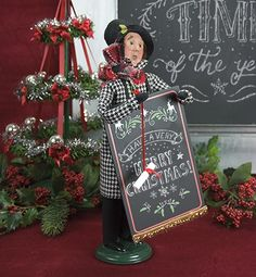 """Byers Choice,Holiday Items,chalkboard,doll,holiday,made in the USA Byers Choice Man with Chalkboard This sophisticated sandwich board man is dressed in a black and white houndstooth jacket. His sandwich board is a real chalkboard that you can use to write your own personalized holiday messages. *Figure comes with removable """"Merry Christmas"""" sticker. Made in the USA13″ Tall"""