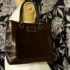 """Kate Spade suede & leather tote Absolutely gorgeous chocolate brown kate spade purse. Suede front & back with leather trim & bottom. Kate spade logo embossed on front, gold hardware with signature spades on all studs. Inside has a zipper pocket in the middle, one inside, & 2 pockets. Excellent condition, only used a few times. No flaws.  Approx. 14"""" long x 12.5"""" tall x 4"""" wide. 9"""" handle drop. kate spade Bags Totes"""