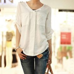Chic Classy Blouse Nice cream coloured blouse that matches nicely with pants or skirts. Gold buttons. New no tags. Tops Blouses