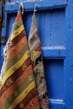 Africa | Woven Rugs Hanging on Door.  Street scene, Essaouria, Morocco |  © Wolfgang Kaehler