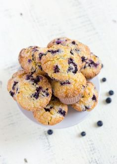 These LEMON BLUEBERRY MUFFINS are tender, fluffy and delicious! This scrumptious muffin recipe is based on iconic department store Jordan Marsh blueberry muffins. #blueberrymuffins #muffinrecipe #muffinrecipes #blueberryrecipes #lemonblueberrymuffins #sou